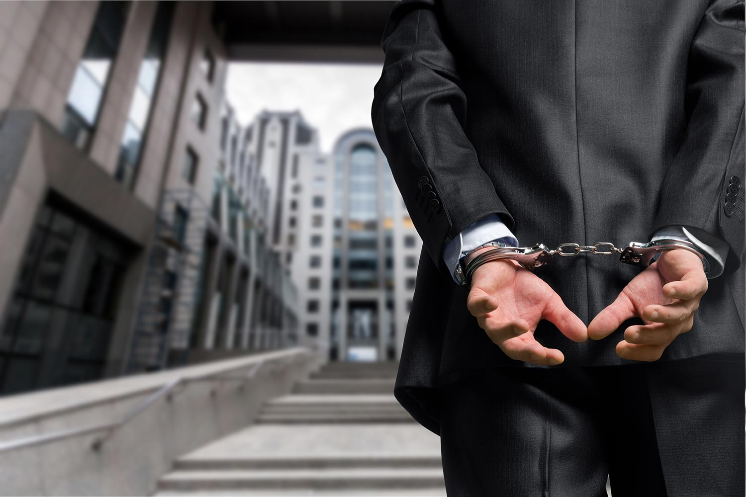 Busiinessman in handcuffs. White Collar Crime attorney in New Jersey and New York